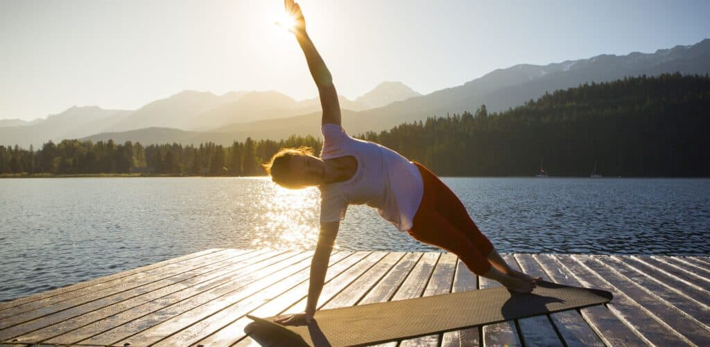 Meditation and yoga practice at sunset or sunrise.